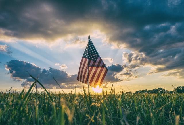 USA flag hoisted in the farm